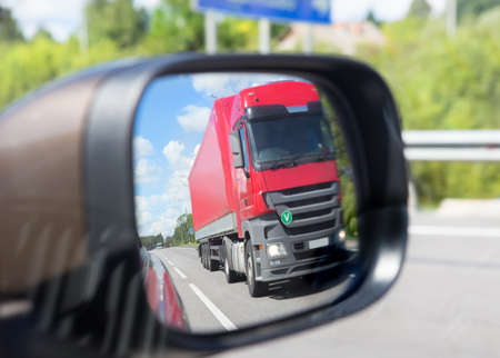 red truck reflection in a car mirror Stock Photo