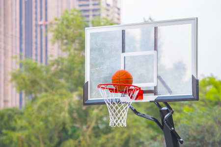 exact hit of a basketball ball into the basket