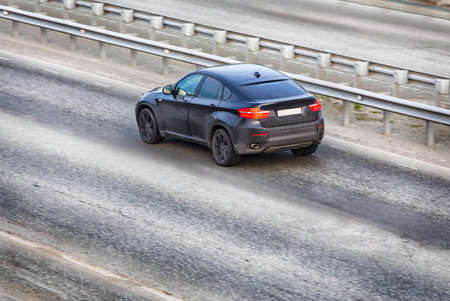 Car modern black on the multiband highway