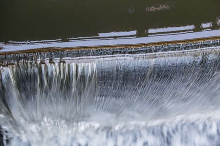 Falling water. Top part of dam with the