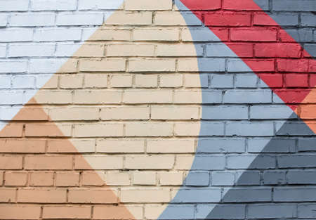 Brick wall with an abstract geometric pattern. Background Stock Photo