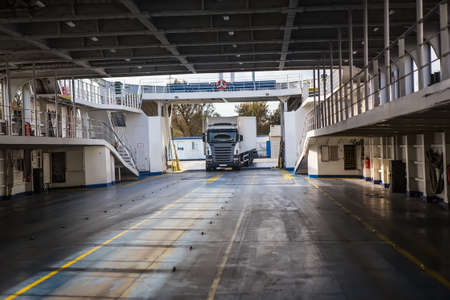 Truck enters an empty sea freight ferry