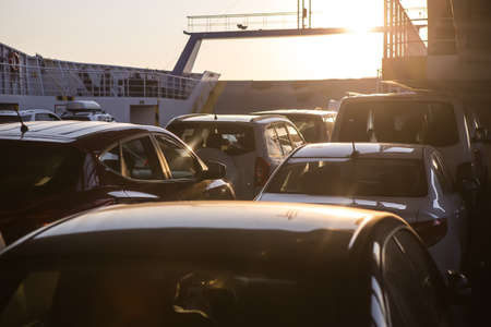 cars on a sea freight ferry in the evening at sunset Zdjęcie Seryjne - 91122197