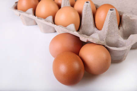A box of chicken eggs. Closeup. Isolated.