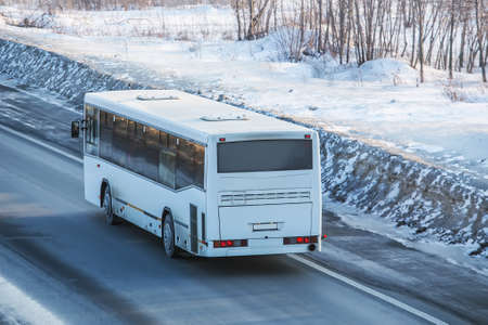 bus is driving on a country road in winter Standard-Bild