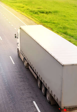 truck transports freight on  country highway