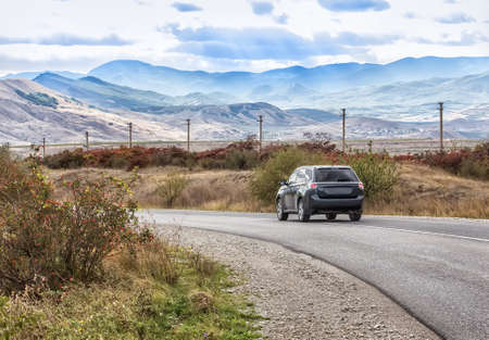 Crossover Rides the Highway in a Beautiful Mountainous Area