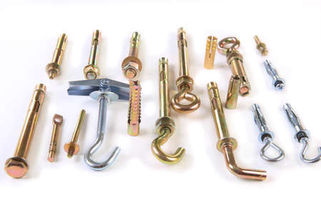 various metal fixing anchors on white background Stock Photo