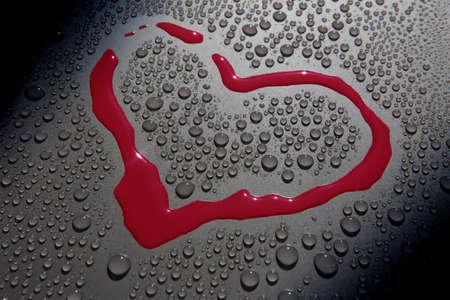 heart symbol blood drop water background