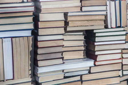lots of books in abstract stacks. Close-up, background