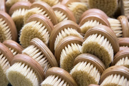 lots of wooden brushes with bristles for cleaning clothes and shoes