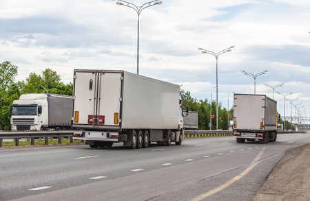 escort of trucks moves on road Stockfoto