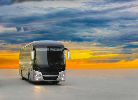 modern tourist bus on asphalt in the evening on sunset