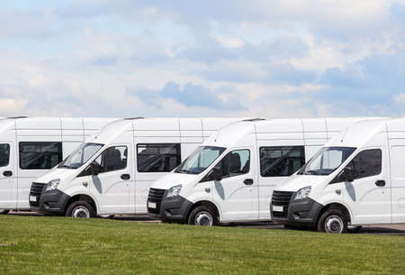 mini buses For Sale Stock Lot Row. Car Dealer Inventory