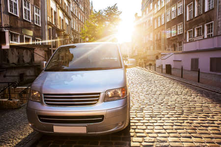 Minivan in the historic center of the city in the morning sun 免版税图像 - 110668423