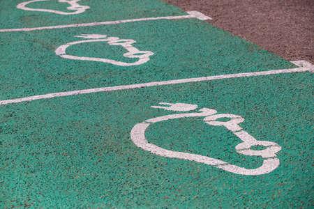electric vehicle charging sign on asphalt
