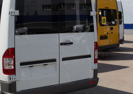New minibus for sale in the parking lot. Dealer Buses Фото со стока