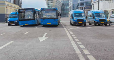 buses move along a multi-lane avenue in the city center