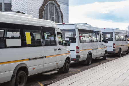 white Shuttle buses at the bus stop Фото со стока