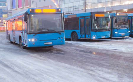 buses in the winter at the bus station in the city