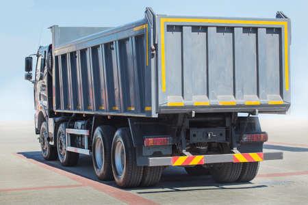 big new dump truck against the sky