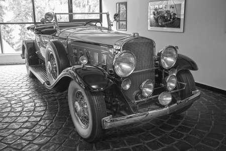 beautiful ancient car in garage near window