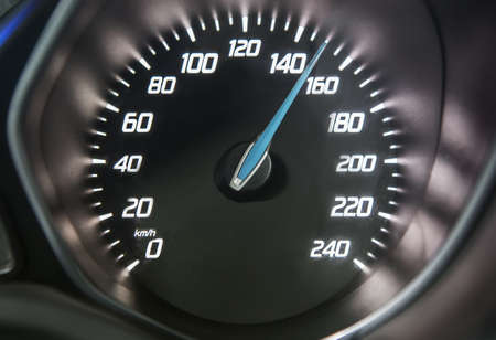 Close up of car speedometer with speed indicating 150 km