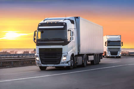 trucks moves on the country highway Imagens