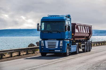 Truck is moving along the coastal road Reklamní fotografie