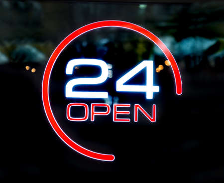 24 hours openly written on the glass entrance door