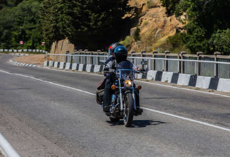 Man And A Woman On a Motorcycle are moving on the Country Highway
