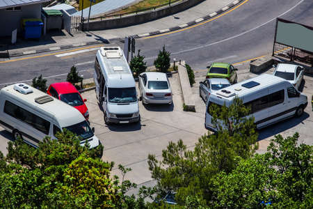 Cars and Buses in the parking lot. Top view 스톡 콘텐츠