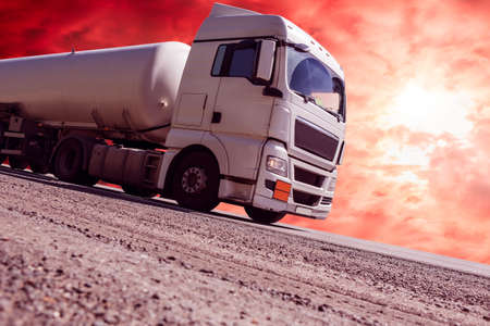 Fuel truck semitrailer delivers fuel on the highway. Stock Photo - 131337809