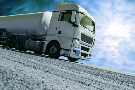 Fuel truck semitrailer delivers fuel on the highway.