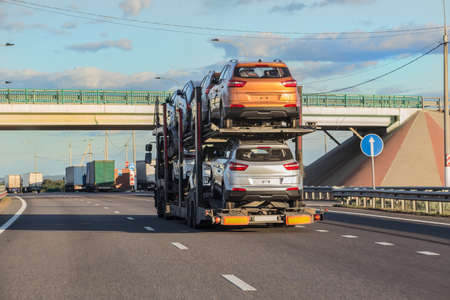 transportation of car on semi-trailer on highway Stock Photo - 131338037