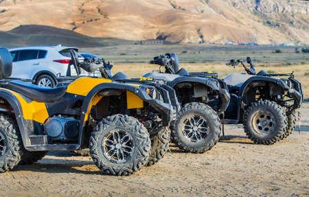 ATVs on the plain near the mountains