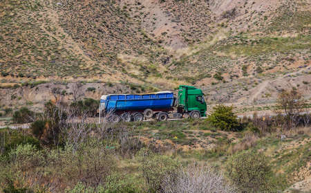 Big Dump Truck moving on a mountain road