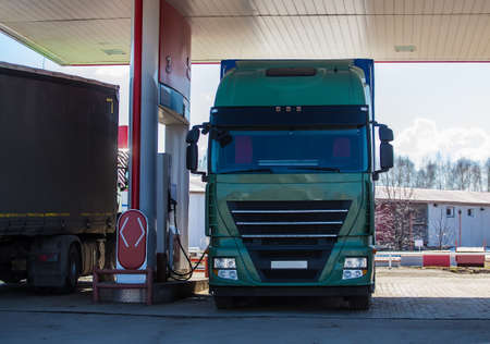 Two trucks at a gas station refuel with diesel Stockfoto