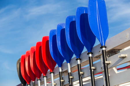 plastic rowing oars against the sky