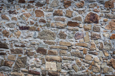 Background.Stone wall of rough unprocessed stones.
