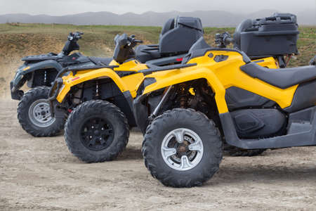 ATVs in the parking lot in the field near the mountains 写真素材