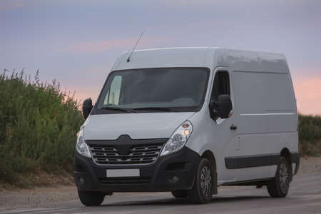 Minibus goes on the country highway Banco de Imagens