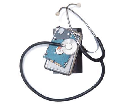 Phonendoscope on computer hard drives. Isolated on white background