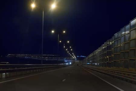 Night highway illuminated by street light Stock Photo