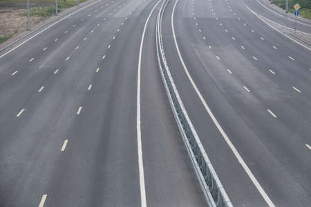 Multi-lane highway with markings on asphalt without cars