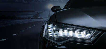 Black car on a moonlit night. Detail close-up.