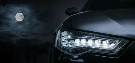 Black car on a moonlit night. Detail close-up. Stock Photo
