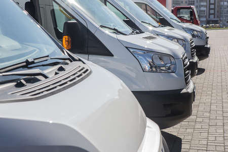 number of new white minibuses and vans outside Standard-Bild