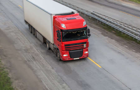 big powerful truck moves on highway Imagens