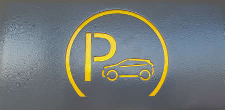 Parking icon on gray metal background.